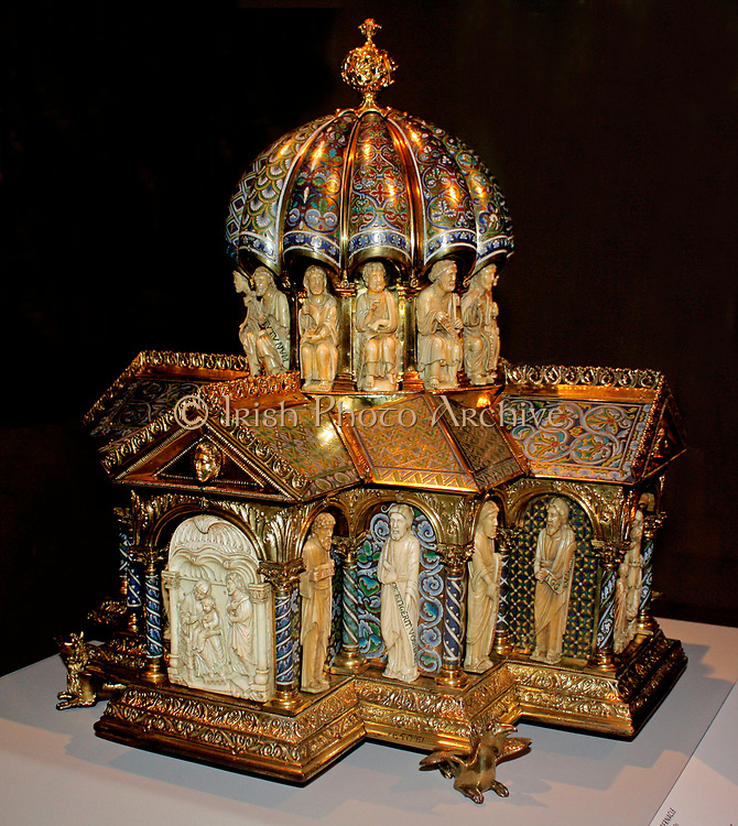 Tabernacle circa 1180. This Romanesque goldsmiths' work and carving combines widely varied foliage patterns with figures that are classically inspired.  Its function has been much debated.  The iconography, or subject matter centre's Christ's redemption o
