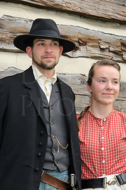 Man and woman from the 1880's American Wild West, a couple in their twenties in reenactor portrayal.