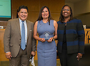 Houston ISD Superintendent Richard Carranza, left, and Grenita Lathan, right, present Maggie Gardea, center with an Excellence in Leadership Award, November 2, 2016.