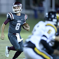 Adam Robison | BUY AT PHOTOS.DJOURNAL.COM<br /> Kossuth's Matthew Bobo runs the ball against the East Side defense in the first quarter.