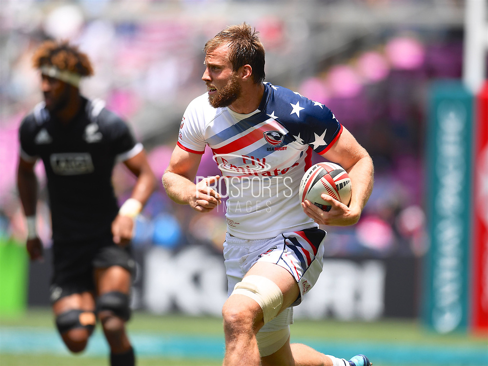 USA player Ben Pinkelman looks for space in the game USA vs New Zealand All Blacks during the Cathay Pacific/HSBC Hong Kong Sevens festival at the Hong Kong Stadium, So Kon Po, Hong Kong. on 8/04/2018. Picture by Ian  Muir.