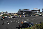 The parking lots begin to fill with tailgating fans in this wide angle, general view photograph taken of Sports Authority Field at Mile High stadium and the downtown Denver skyline before the Denver Broncos 2016 NFL week 1 regular season football game against the Carolina Panthers on Thursday, Sept. 8, 2016 in Denver. The Broncos won the game 21-20. (©Paul Anthony Spinelli)