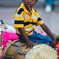 CARTAGENA , COLOMBIA - DEC 22 : Local child sitting on a drum while preparation for the celebration , held in the Unesco world heritage city of Cartagena , Colombia on December 22 2010