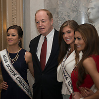U.S. Senator Richard Shelby, Republican of Alabama, stands with three beauty queens in the U.S. Capitol on April 15, 2015. From the left, Miss South Carolina, Sarah Weishuhn; Senator Shelby; Miss Alabama, Madison Guthrie; and Miss Louisiana, Candice Bennatt.