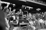 03/09/1967<br /> 09/03/1967<br /> 3 September 1967<br /> All-Ireland Minor Hurling Final: Cork v Wexford at Croke Park, Dublin.<br /> Taoiseach, Mr. Jack Lynch presenting the Minor All-Ireland Hurling Cup to Paddy Ring, captain of the Cork Team, with some of the victorious team cheering.