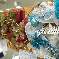 In addition to decorated Christmas trees, Soroptimist International is raffling holiday wreaths at the annual Festival of Trees at the Rio West Mall in Gallup Thursday. The blue and white wreath was created sand donated by U.S. Bank in Gallup. All proceeds from the raffle go towards Soroptimist's philanthropic endeavors to help women.