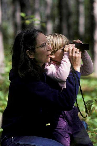 Education, mother and child looking through binoculars at subjects.