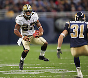 ST. LOUIS - SEPTEMBER 23:  Running back Aaron Stecker #27 of the New Orleans Saints tries to avoid a tackle by safety Adam Archuleta #31 of the St. Louis Rams at the Edward Jones Dome on September 23, 2005 in St. Louis, Missouri. The Rams defeated the Saints 28-17. ©Paul Anthony Spinelli *** Local Caption *** Aaron Stecker;Adam Archuleta