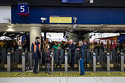 © Licensed to London News Pictures. 31/12/2017. London, UK. Passengers leaving a South Western Railway service at London Waterloo Station. Thousands of passengers travelling to celebrations on New Year's Eve are expected to face delays and cancellations because of a 24-hour walkout.  Photo credit: Rob Pinney/LNP