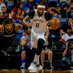 Mar 31, 2017; New Orleans, LA, USA; New Orleans Pelicans forward DeMarcus Cousins (0) steals the ball from Sacramento Kings center Willie Cauley-Stein (00) during the first quarter of a game at the Smoothie King Center. Mandatory Credit: Derick E. Hingle-USA TODAY Sports