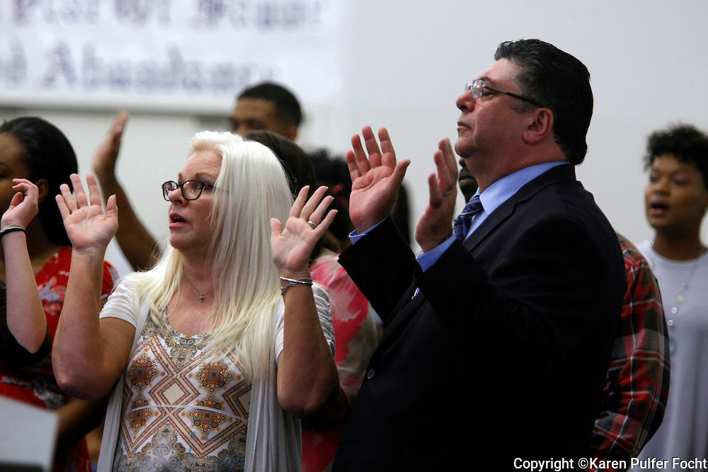 Alonso Esposito, a former Boston mobster-turned pastor, prays with the congregation at Faith Keepers Ministry in Memphis on Sunday, June 26th, 2016.