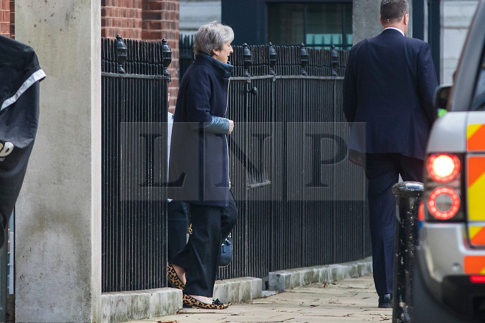 © Licensed to London News Pictures. 22/02/2018. London, UK. Prime Minister THERESA MAY leaves Downing Street via the back door as she heads to Chequers for the meeting of the Brexit sub-committee of the Cabinet. Photo credit: Rob Pinney/LNP