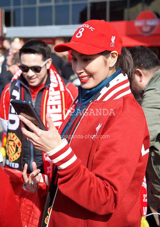 LIVERPOOL, ENGLAND - Sunday, March 22, 2015: A female Liverpool supporter from Thailand before the Premier League match against Manchester United at Anfield. (Pic by David Rawcliffe/Propaganda)