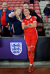 SOUTHAMPTON, ENGLAND - Friday, April 6, 2018: Wales' Natasha Harding poses for a photograph with supporters as the team celebrate after a hard fought goal-less draw against England during the FIFA Women's World Cup 2019 Qualifying Round Group 1 match between England and Wales at St. Mary's Stadium. (Pic by David Rawcliffe/Propaganda)