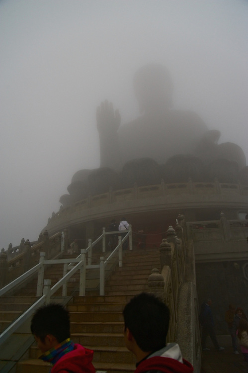 Visitors head toward the Big Buddha on Lantau, Hong Kong, on a foggy first day of the Lunar New Year, 2009