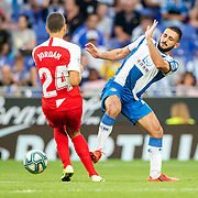 BARCELONA, SPAIN - August 18:  Joan Jordan #24 of Sevilla challenged by Matias Vargas #22 of Espanyol during the Espanyol V  Sevilla FC, La Liga regular season match at RCDE Stadium on August 18th 2019 in Barcelona, Spain. (Photo by Tim Clayton/Corbis via Getty Images)