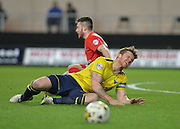 Oxford United Defender Johnny Mullins fouled by York City forward Bradley Fewster during the Sky Bet League 2 match between Oxford United and York City at the Kassam Stadium, Oxford, England on 1 March 2016. Photo by Adam Rivers.
