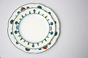 Elevated view of a set of plates on white tablecloth