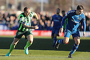 AFC Wimbledon defender & captain Barry Fuller (2) chases Curzon Ashton striker Adam Morgan (7) during the The FA Cup match between Curzon Ashton and AFC Wimbledon at Tameside Stadium, Ashton Under Lyne, United Kingdom on 4 December 2016. Photo by Stuart Butcher.