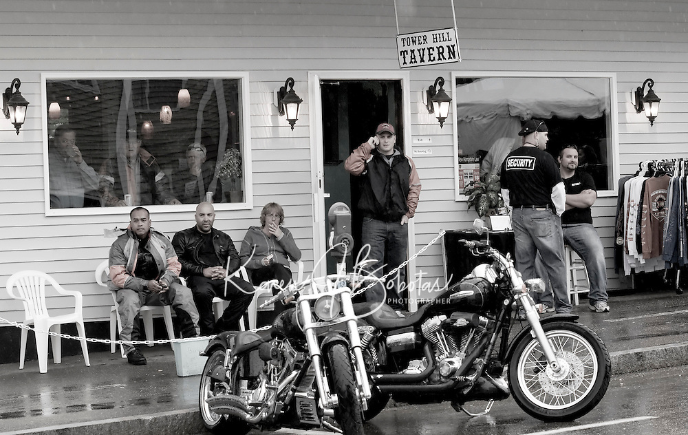 Bikers at the Tower Hill Tavern on Lakeside Avenue watching the rain fall Thursday evening.  (Karen Bobotas/for the Laconia Daily Sun)