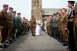 Guard of Honor Northern World War 2 Association members representing both Allied and Axis sides of the conflict turn out in force for the 1940s wedding of Kath and Andy held at Saint John The Divine Church Lytham. Both members of the  Northern World War 2 Association Andy  and Kath chose to tie the knot surround by family and friends during the Lytham 1940's war weekend.19 August 2011  Image © Paul David Drabble
