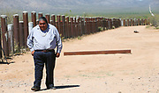 Verlon Jose, vice-chairman of the Tohono O'odham Nation, walks along the vehicle barrier on the U.S. - Mexico border on the Tohono O'odham reservation in Chukut Kuk, Arizona April 6, 2017. Picture taken April 6, 2017.  REUTERS/Rick Wilking