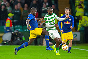Dayat Upamecano (#5) of RB Leipzig tackles Odsonne Edouard (#22) of Celtic FC during the Europa League group stage match between Celtic and RP Leipzig at Celtic Park, Glasgow, Scotland on 8 November 2018.