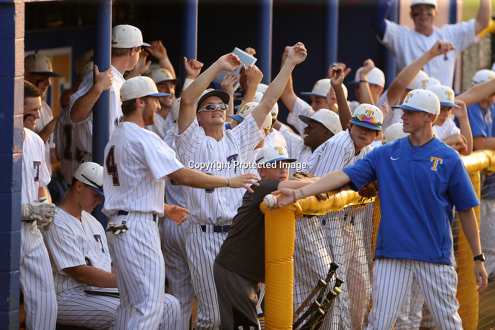 Members of the Tupelo baseball team celebrate after their first hit and getting a player on base agaist Hernando in the forst inning Thursday night.