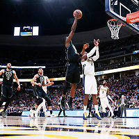 01 April 2018: Milwaukee Bucks guard Tony Snell (21) goes for the layup during the Denver Nuggets 128-125 victory over the Milwaukee Bucks, at the Pepsi Center, Denver, Colorado, USA.