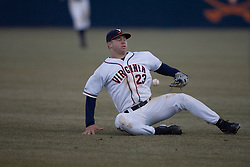 Virginia Cavaliers infielder David Adams (23) tries to control a ground ball against Bucknell.  The Virginia Cavaliers Baseball Team defeated the Bucknell University Bison 2-0 at Davenport Field in Charlottesville, VA on February 23, 2007.