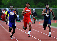 14 MAY 2011 -- ST. LOUIS -- Christian Brothers College High School runner Jamal Robinson (left) duels Kirkwood High School's Quincy Sharp and Parkway South High School's Lawrence Scott during the boys' 100-meter dash during the MSHSAA Class 4, District 2 track meet at Eureka High School in Eureka, Mo. Saturday, May 14, 2011. Image © copyright 2011 Sid Hastings.