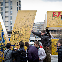 "Pristina, Kosovo 17 February 2011<br /> Youngsters write on the ""Newborn"" monument, during the celebrations of the 3rd anniversary of Kosovo's Independence.<br /> After the Kosovo War and the 1999 NATO bombing of Yugoslavia, the territory of Kosovo came under the interim administration of the United Nations Mission in Kosovo (UNMIK), and most of those roles were assumed by the European Union Rule of Law Mission in Kosovo (EULEX) in December 2008. <br /> In February 2008 individual members of the Assembly of Kosovo declared Kosovo's independence as the Republic of Kosovo. Its independence is recognised by 75 UN member states. <br /> On 8 October 2008, upon request of Serbia, the UN General Assembly adopted a resolution asking the International Court of Justice for an advisory opinion on the issue of Kosovo's declaration of independence.<br /> On 22 July 2010, the ICJ ruled that Kosovo's declaration of independence did not violate international law, which its president said contains no ""prohibitions on declarations of independence"".<br /> Photo: Ezequiel Scagnetti"