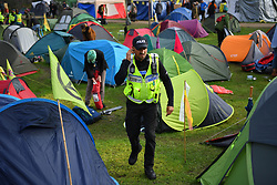 "© Licensed to London News Pictures. 15/10/2019. London, UK. The XR camp at Vauxhall Pleasure Gardens in South London is cleared by police under a revised section 14 order issued on Monday night that stated ""any assembly linked to the Extinction Rebellion 'Autumn Uprising' ... must now cease their protests within London"" .  Photo credit: Guilhem Baker/LNP"