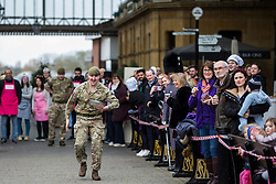 Windsor, UK. 25 February, 2020. A soldier from the 1st Battalion Welsh Guards pulls a muscle as he competes on Shrove Tuesday in the Windsor and Eton Flippin' Pancake Challenge in aid of Alexander Devine Children's Hospice Service.