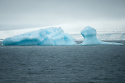 A large iceberg off the coast of one of more than two hundred islands that make up Franz Josef Land, an archipelago in the Arctic Ocean that belongs to Russia and contains the highest latitude landmass on earth.