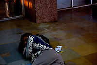 A man sleeps on the floor outside of a ticket office at the train station in Jaipur City india Nov. 15, 2006 Jaipur India.    (photo by Darren Hauck).................