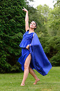 Old Westbury, New York, U.S. 22nd June 2013. Dancer in Lori Belilove & The Isadora Duncan Dance Company, with the Beliloveables, dances in flowing blue gown at the Midsummer Night event at Old Westbury Gardens, on the grounds of the historic Long Island Gold Coast estate.