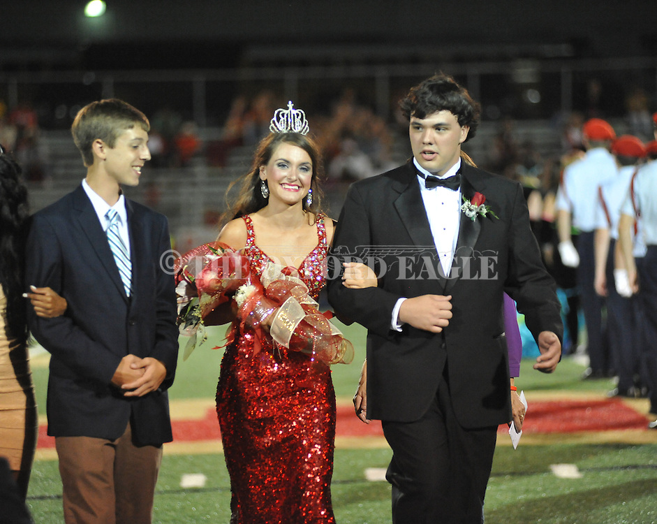 Senior maid Katie Tidwell is escorted by Taylor Mooney, is named queen during Homecoming at Lafayette High vs. Shannon in Oxford, Miss. on Friday, September 19, 2014. Lafayette High won 35-0 to improve to 2-3 on the season.
