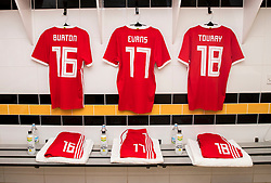 NEWPORT, WALES - Tuesday, October 16, 2018: The shirts of Robbie Burton, Connor Evans, and Momodou Touray hang in the dressing room ahead of the UEFA Under-21 Championship Italy 2019 Qualifying Group B match between Wales and Switzerland at Rodney Parade. (Pic by Laura Malkin/Propaganda)