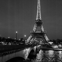 The Eiffel Tower pictured at dusk along The  Seine River in Paris, France 2015.