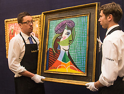 Sotheby's, London, January 28th 2016. Gallery Technicians hand Pablo Picasso's 1935 painting  Tête De Femme, which is expected to fetch between £16-20 million when it is to be auctioned by Sotheby's in London as part of their sale of Impressionist, Modern, Surrealist and Contemporary art. ///FOR LICENCING CONTACT: paul@pauldaveycreative.co.uk TEL:+44 (0) 7966 016 296 or +44 (0) 20 8969 6875. ©2015 Paul R Davey. All rights reserved.Sotheby's, London, January 28th 2016. Gallery Technicians hand Pablo Picasso's 1935 painting  Tête De Femme, which is expected to fetch between £16-20 million when it is to be auctioned by Sotheby's in London as part of their sale of Impressionist, Modern, Surrealist and Contemporary art. ///FOR LICENCING CONTACT: paul@pauldaveycreative.co.uk TEL:+44 (0) 7966 016 296 or +44 (0) 20 8969 6875. ©2015 Paul R Davey. All rights reserved.