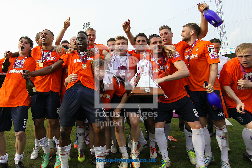 Luton Town players celebrate winning the Skrill Conference Premier league title and a return to the Football League after five years in the fifth tier of English football after the Skrill Conference Premier match at Kenilworth Road, Luton<br /> Picture by David Horn/Focus Images Ltd +44 7545 970036<br /> 21/04/2014