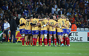 The Romanian team prior to kick off during the Rugby World Cup Pool D match between France and Romania at the Queen Elizabeth II Olympic Park, London, United Kingdom on 23 September 2015. Photo by Matthew Redman.