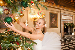 Chatsworth House Press Launch - On the Eve of its The Nutcracker themed Christmas Season Opening, Ballerina  Daisy Kerry hangs bauble from on of Chatsworths many Christmas trees in the painted hall<br /> <br />   04 October 2016<br />   Copyright Paul David Drabble<br />   www.pauldaviddrabble.photoshelter.com