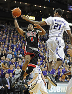 KANSAS CITY, MO - DECEMBER 21:  Guard Oscar Bellfield #0 of the UNLV Runnin' Rebels drives to the basket against pressure from forward Jordan Henriquez-Roberts #21 of the Kansas State Wildcats during the first half on December 21, 2010 at the Sprint Center in Kansas City, Missouri.  UNLV defeated Kansas State 63-59.  (Photo by Peter G. Aiken/Getty Images) *** Local Caption *** Oscar Bellfield;Jordan Henriquez-Roberts