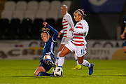 Caroline Weir (#9) (Manchester City) of Scotland slide tackles Mallory Pugh (#11) (Washington Spirit) of the USA during the Women's International Friendly match between Scotland Women and USA at the Simple Digital Arena, Paisley, Scotland on 13 November 2018.