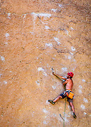 Rock climber on one of the the Dihedral wall routes at Smith Rock State Park, Oregon