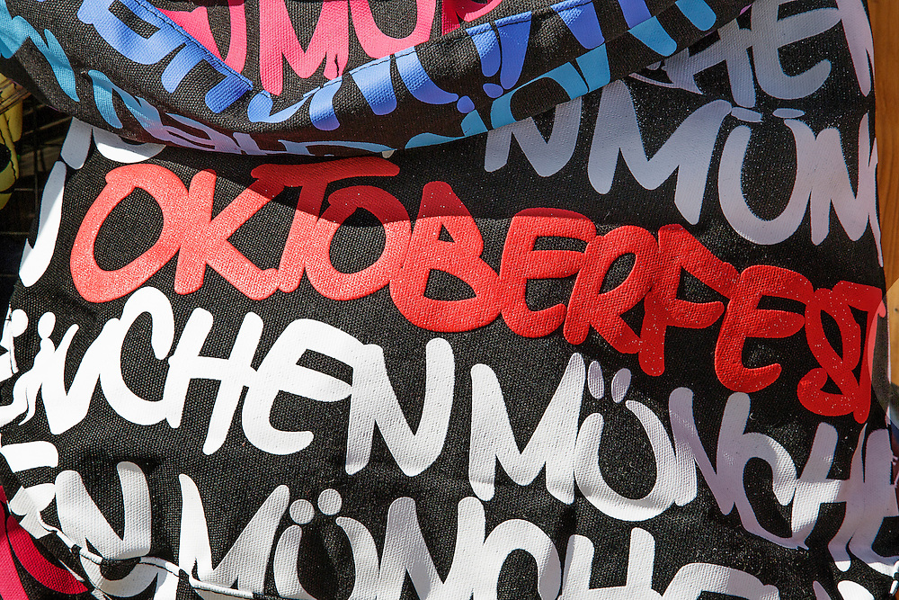 A tote bag with the words' Oktoberfest Munchen' in red and white text found on a market stall in Munich.