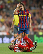 FC Barcelona's Carles Puyol (t) and Sporting de Gijon's David Barral during  La Liga match.August 31 2009.