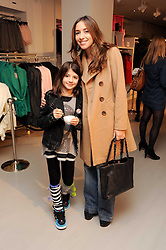 MELANIE BLATT and her daughter LILY at the H&M Home Launch held at 174-176 Oxford Street, London W1 on 2nd November 2010.